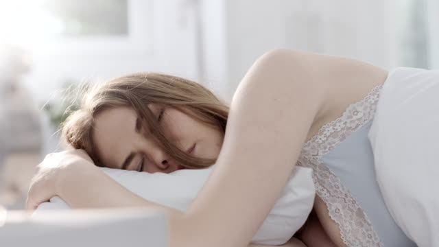 Woman having restless sleep