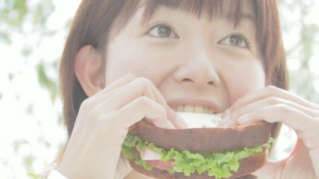Woman having sandwich
