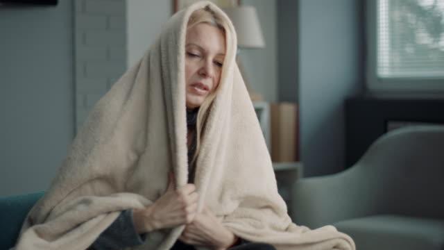 woman having severe flu at home - symptom stock videos & royalty-free footage