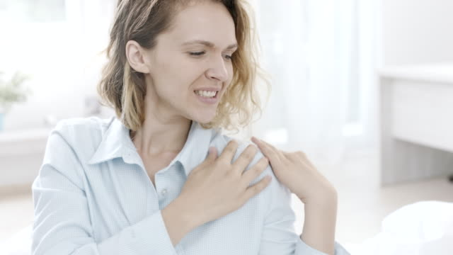 woman having shoulder pain - pain stock videos & royalty-free footage