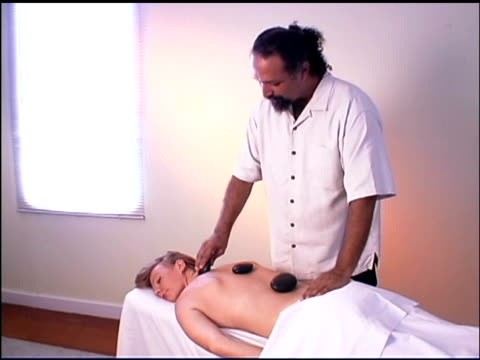 woman having spa treatment - lastone therapy stock videos and b-roll footage