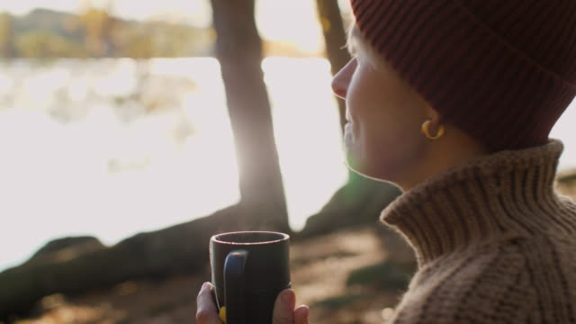 a woman having tea outdoor in autumn - tights stock videos & royalty-free footage