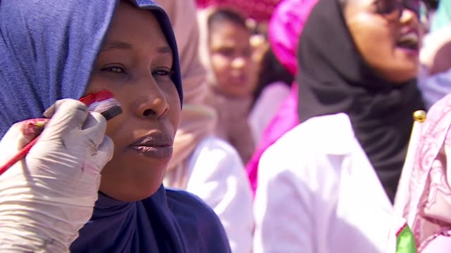 Woman having the Sudanese flag painted on her cheek for the political protests in Khartoum Sudan