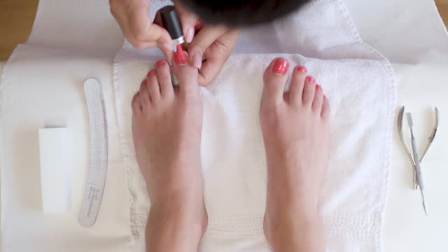 woman having toenails painted - painting toenails stock videos & royalty-free footage