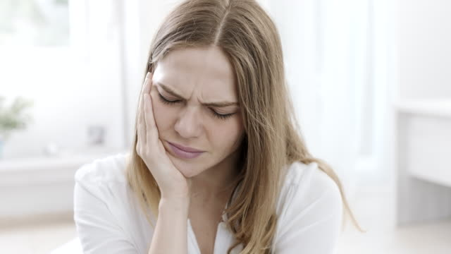 woman having tooth pain - pain stock videos & royalty-free footage