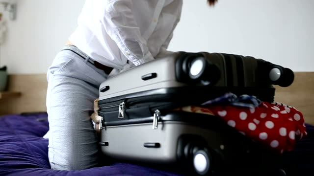 woman having trouble packing - full stock videos & royalty-free footage