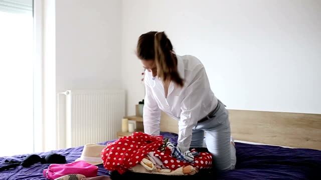 Woman having trouble packing