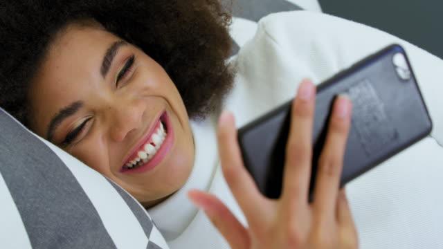 woman having video conference - 横向きに寝る点の映像素材/bロール