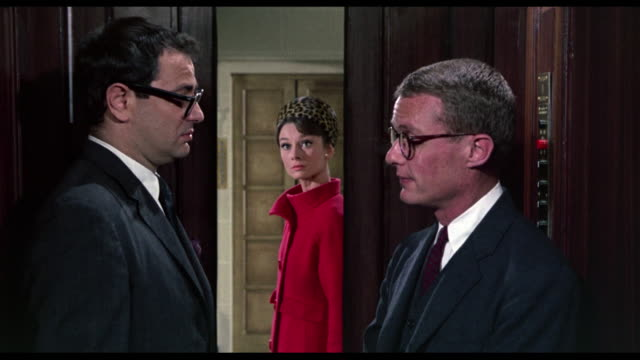 1963 woman (audrey hepburn) hears disturbing conversation on elevator of american embassy - ethik und moral stock-videos und b-roll-filmmaterial
