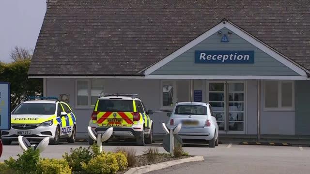 woman held on manslaughter charges after 10-year-old boy dies in dog attack; england: cornwall: looe: tencreek holiday park: ext police officer in... - gazebo stock videos & royalty-free footage