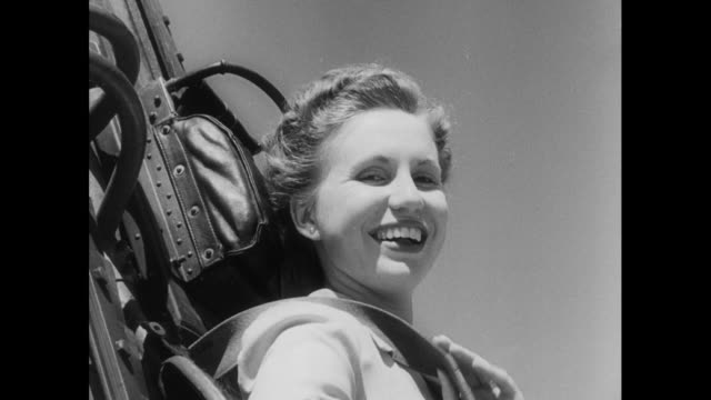 woman helped on to ejector seat test machine; 1952 - vehicle seat stock videos & royalty-free footage