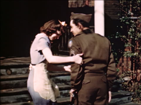 1946 REAR VIEW woman helping wounded soldier / husband walk up steps / industrial