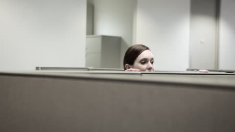 woman hiding behind cubicle in office - hiding stock videos & royalty-free footage