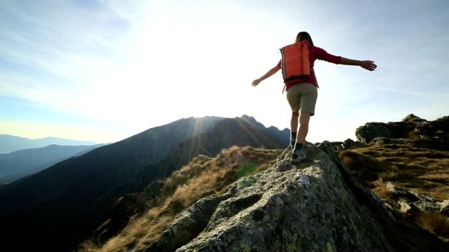 woman hiker walking on mountain ridge crest - reaching stock videos and b-roll footage