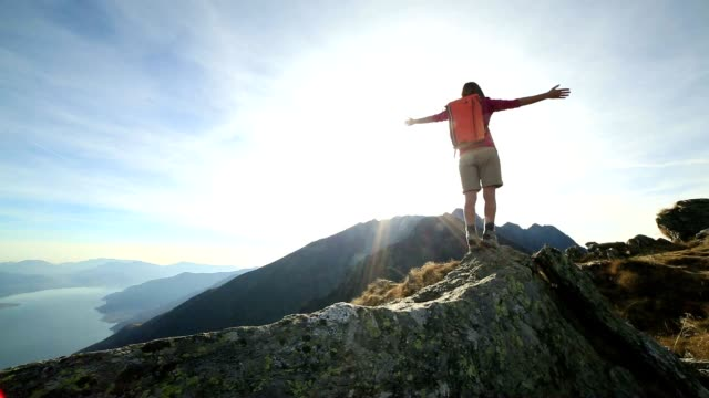 woman hiker walking on mountain ridge crest - mountain peak stock videos & royalty-free footage