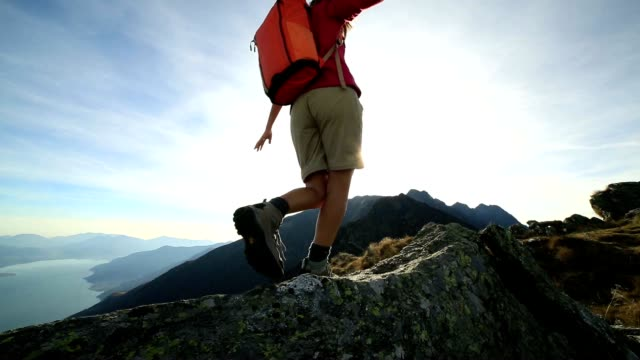 woman hiker walking on mountain ridge crest - mountain peak stock videos and b-roll footage