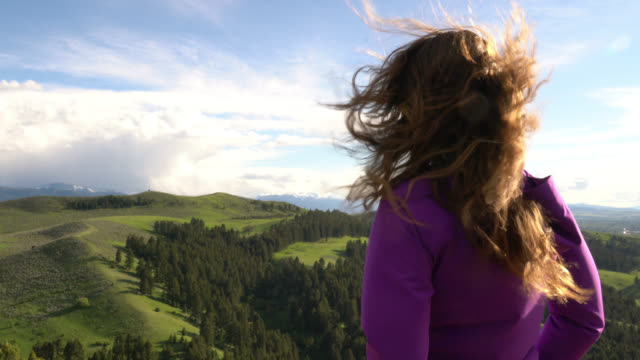 a woman hiking a scenic trail in montana - jacket stock videos and b-roll footage