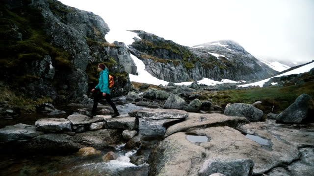 woman hiking in mountains  in norway - north stock videos and b-roll footage