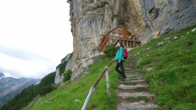 woman hiking in swiss alps in appenzell - shack stock videos & royalty-free footage