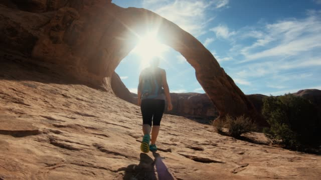 Woman hiking near Corona arch, Moab