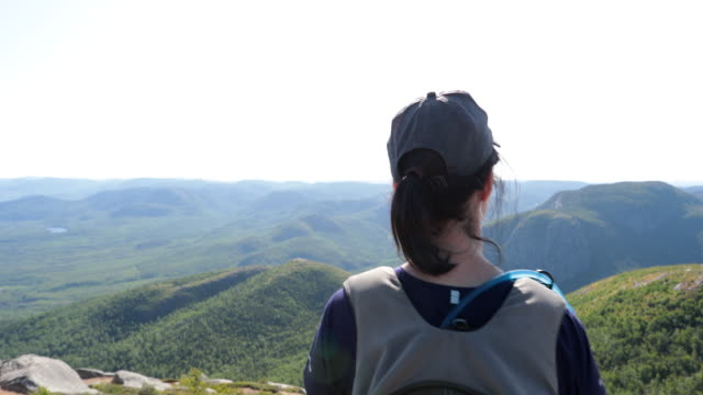 woman hiking to mountain peak at parc national des grands-jardins, quebec, canada - parc national stock videos & royalty-free footage