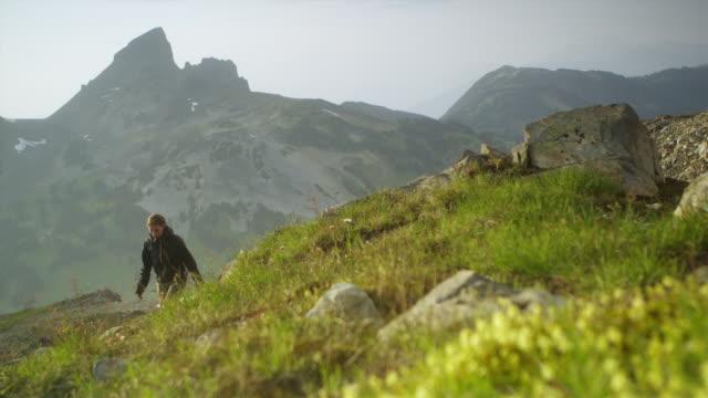 ms la selective focus woman hiking up mountain ridge, garibaldi provincial park, squamish, british columbia, canada - garibaldi park stock videos & royalty-free footage