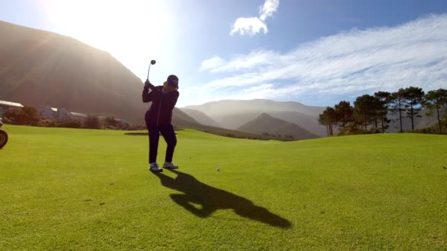 Woman hitting a golf shot