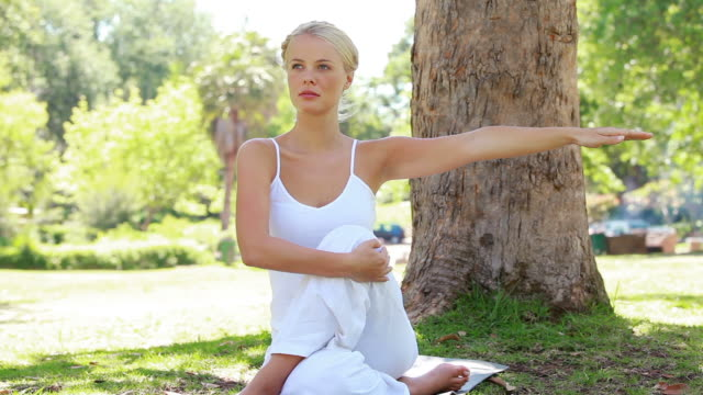 A woman hold her yoga pose