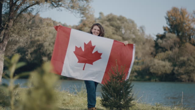 woman holding a canadian flag - canadian flag stock videos & royalty-free footage