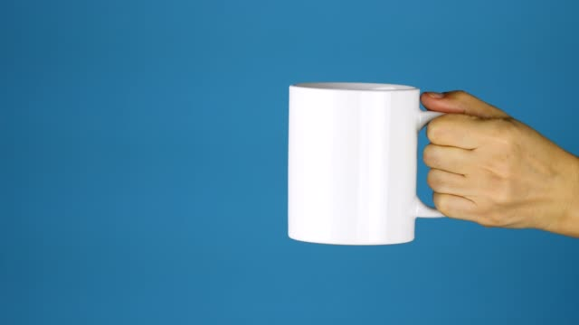 woman holding a ceramic cup, relaxing, blank, blue background, breakfast, cafe - mug stock videos & royalty-free footage