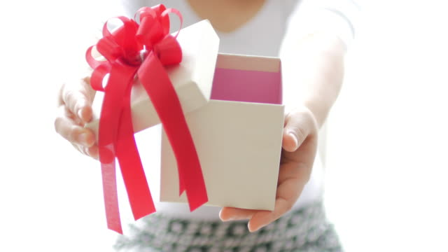 Woman holding a gift and open gift box