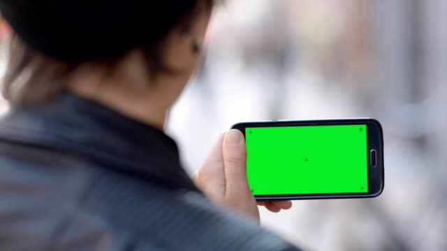 woman holding a green screen device - horizontal stock videos & royalty-free footage