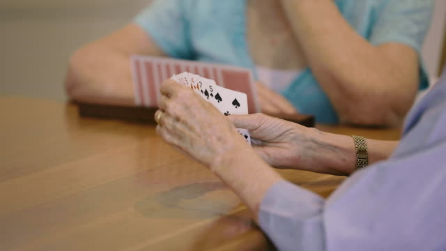 woman holding a hand of cards - hand of cards stock videos & royalty-free footage