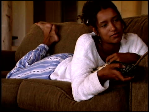 woman holding a remote - african american culture stock videos & royalty-free footage