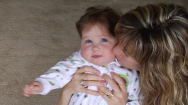 ha ms portrait woman holding and kissing baby girl/ vancouver, bc - babygro stock videos & royalty-free footage