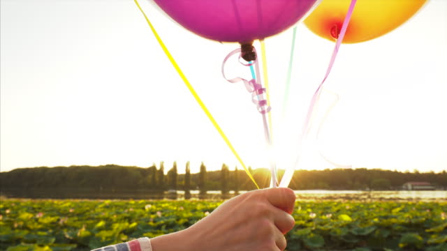 woman holding balloons. - bunch stock videos and b-roll footage