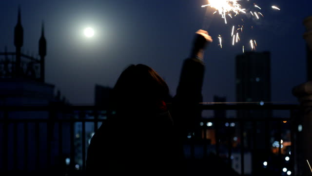 woman holding burning sparklers - only mid adult women stock videos and b-roll footage