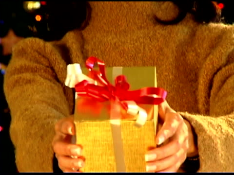 woman holding christmas gift - only mid adult women stock videos & royalty-free footage