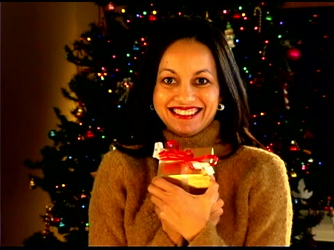 woman holding christmas gift - one mid adult woman only stock videos & royalty-free footage