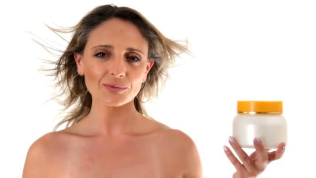 Woman holding cream jar