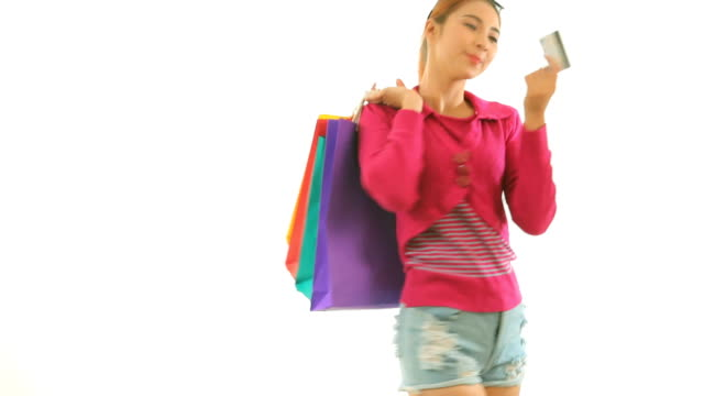 Woman holding credit card and shopping bags