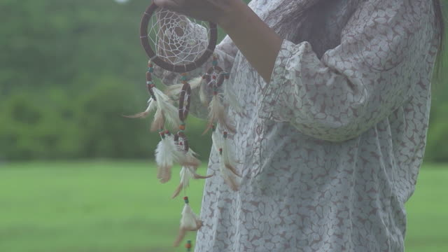 woman holding dream catcher - indigenous north american culture stock videos and b-roll footage