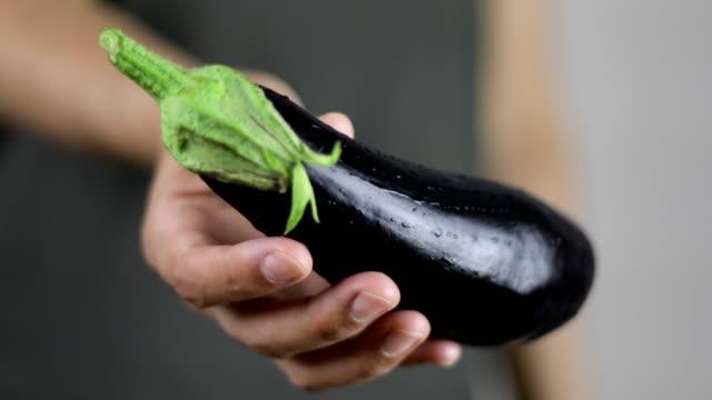 woman holding eggplant - aubergine stock videos & royalty-free footage