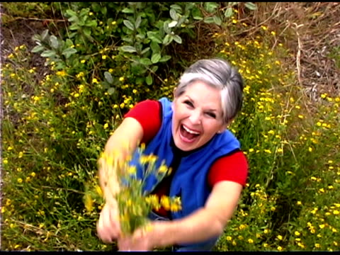 woman holding flowers - bald head island stock videos and b-roll footage