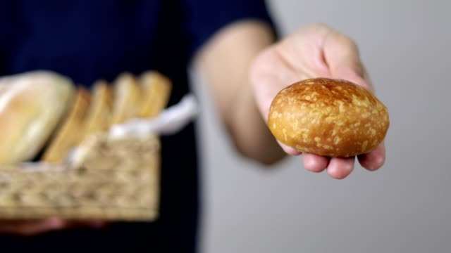 woman holding fresh cooked bread - wholegrain stock videos & royalty-free footage