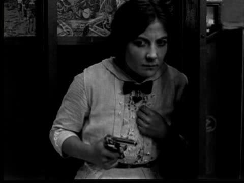 1913 b/w ms woman (mary fuller) holding gun, then gasps / usa - 1913 stock-videos und b-roll-filmmaterial