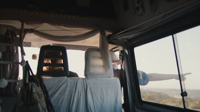 woman holding hand out of window on road trip with friends - passenger seat stock videos & royalty-free footage