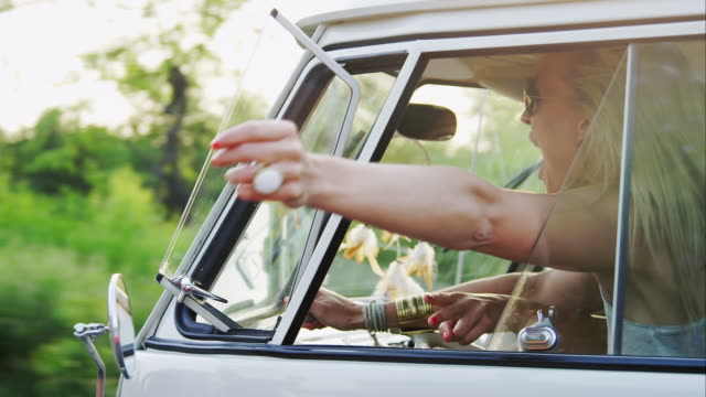woman holding hand out of window while driving - summer stock videos & royalty-free footage