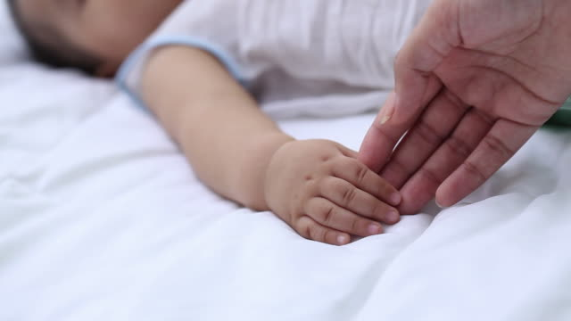 woman holding hands of her son  - simple living stock videos & royalty-free footage