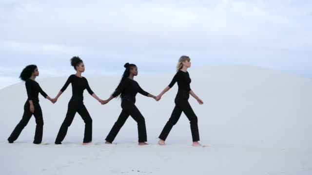woman holding hands walk through desert, medium shot - fashion model stock videos & royalty-free footage